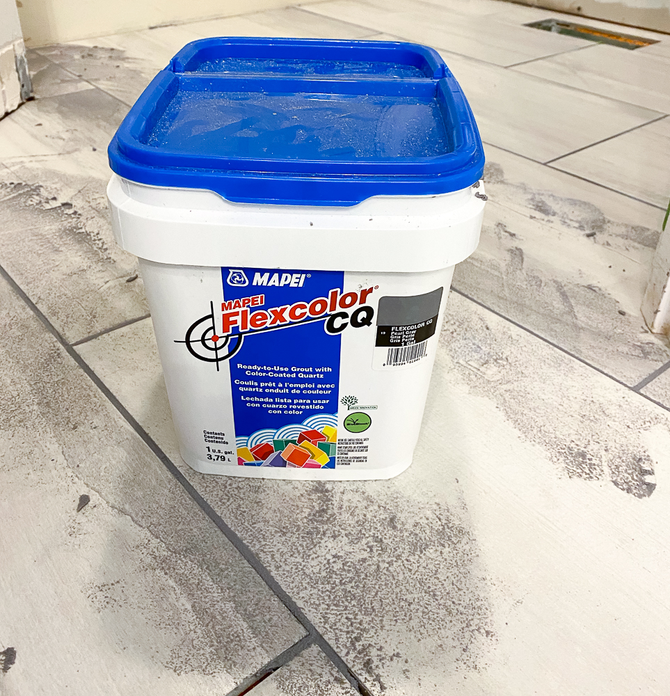 container of grout for tiling