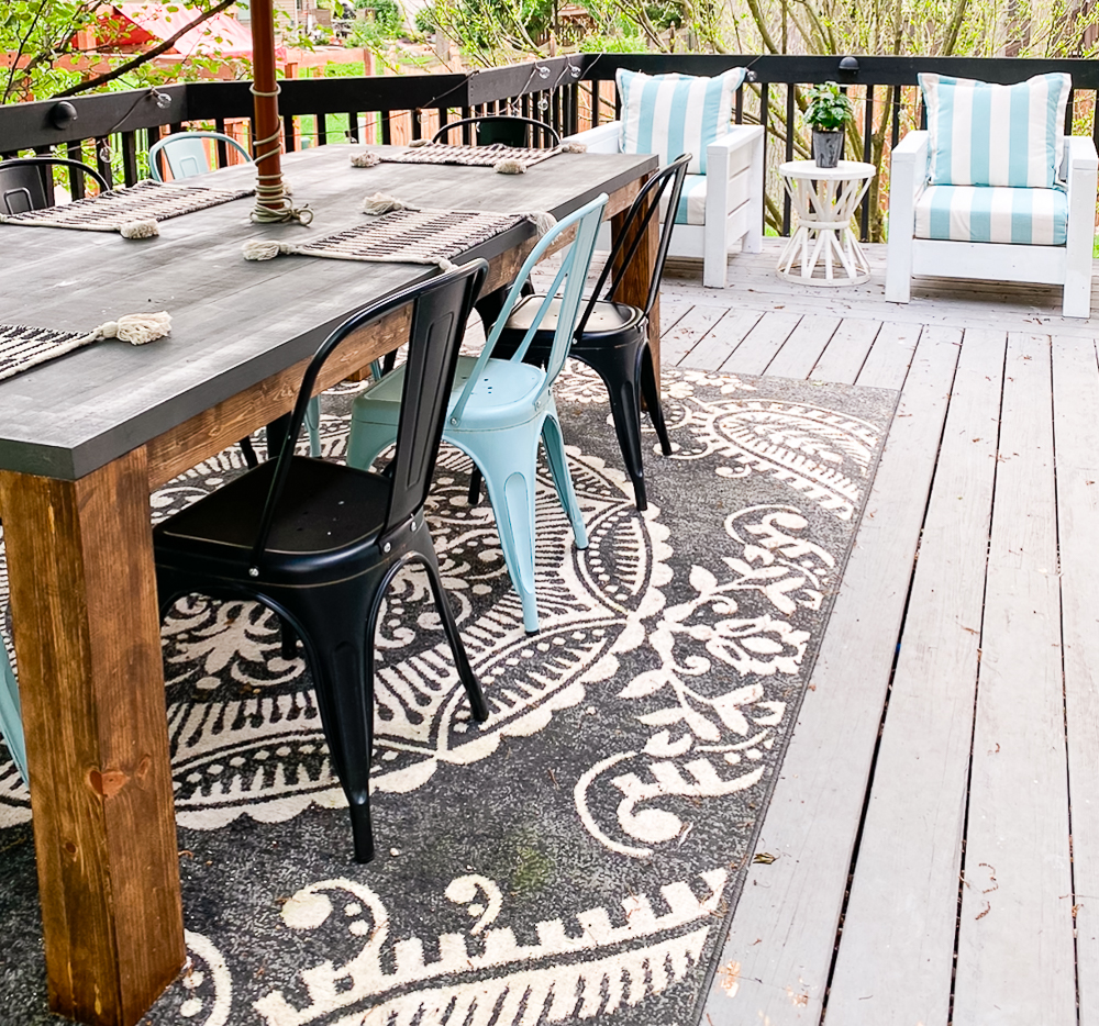 outdoor space deck with rug and farmhouse table
