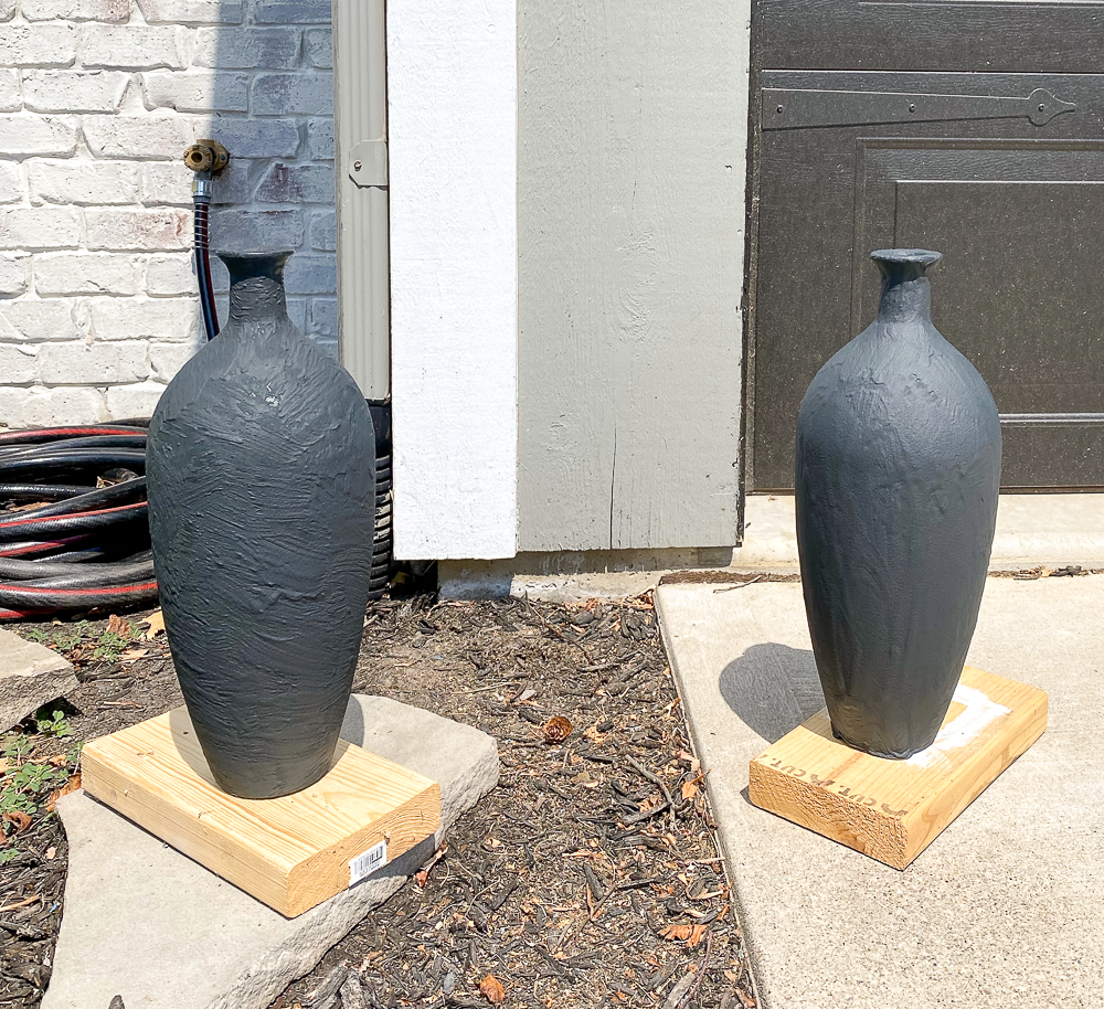 two vases outside with paint drying