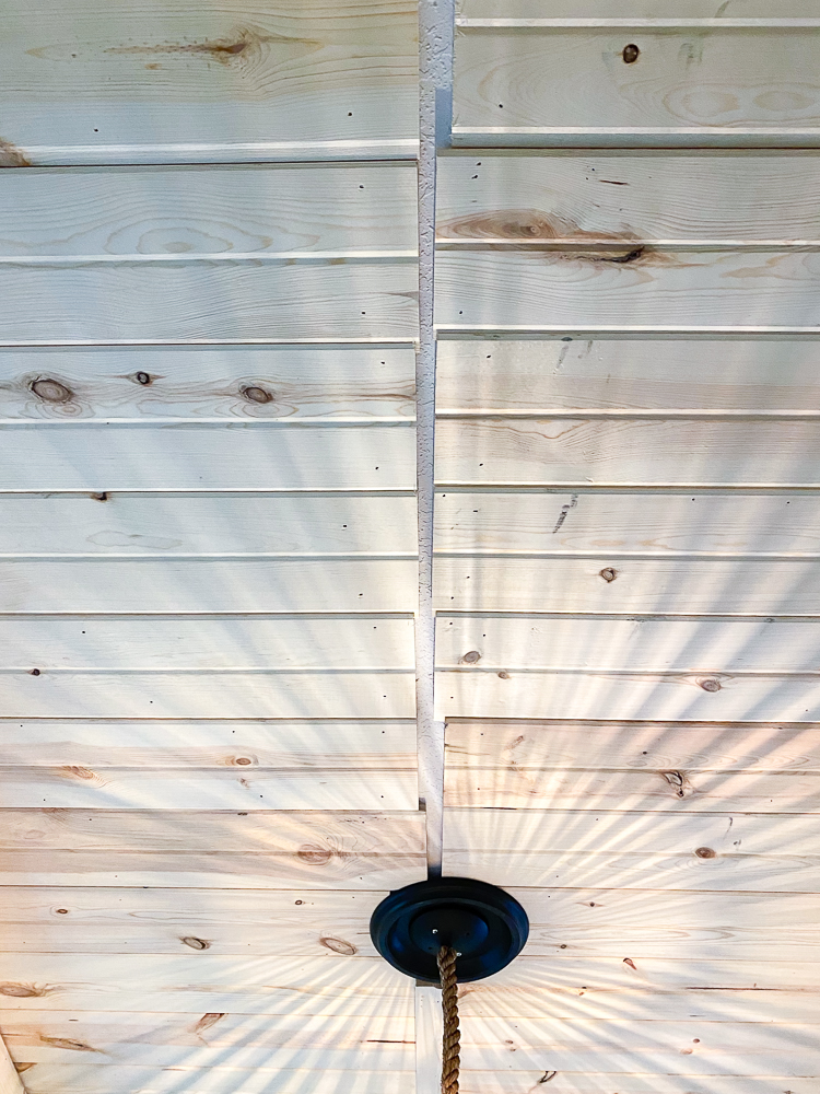 Planked ceiling with a crease where the boards meet