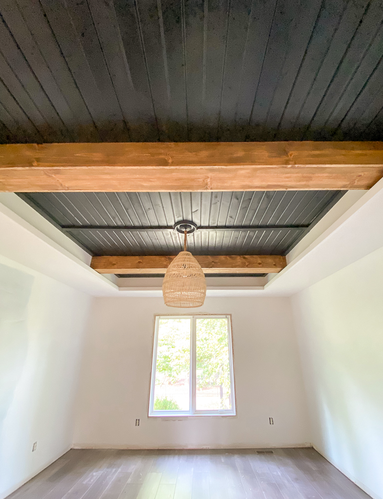 Master bedroom reveal: Carsiding tray ceiling with faux beams and basket light