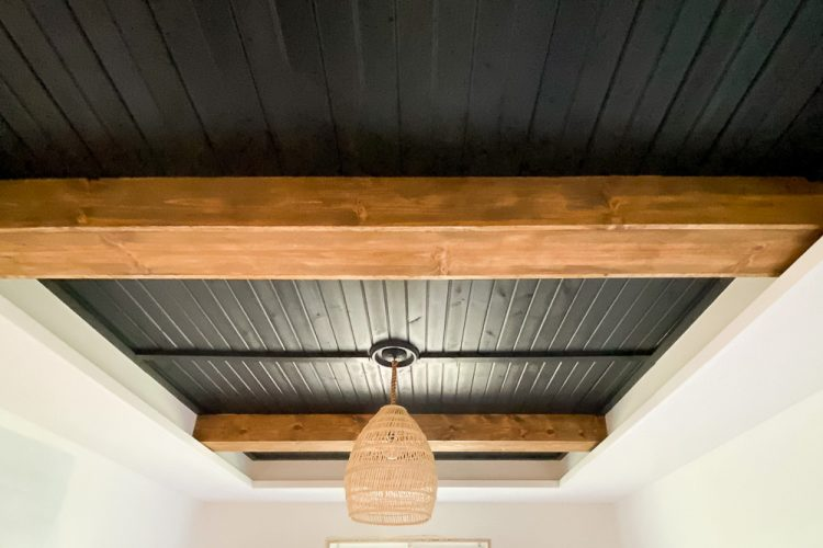 black planked ceiling with stained ceiling beams