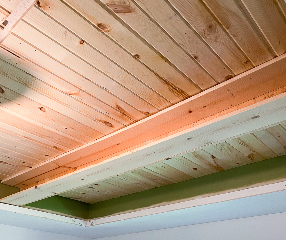Carsiding tray ceiling with faux beam