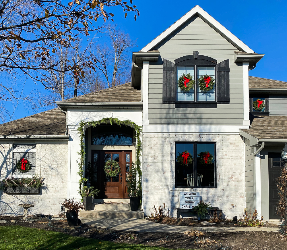 Daytime view of house decked out for Christmas
