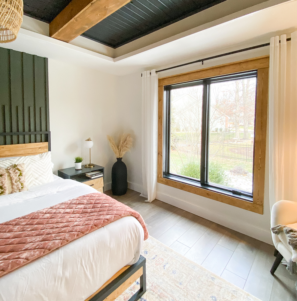 Master bedroom with craftsman trim and mid century modern style decor