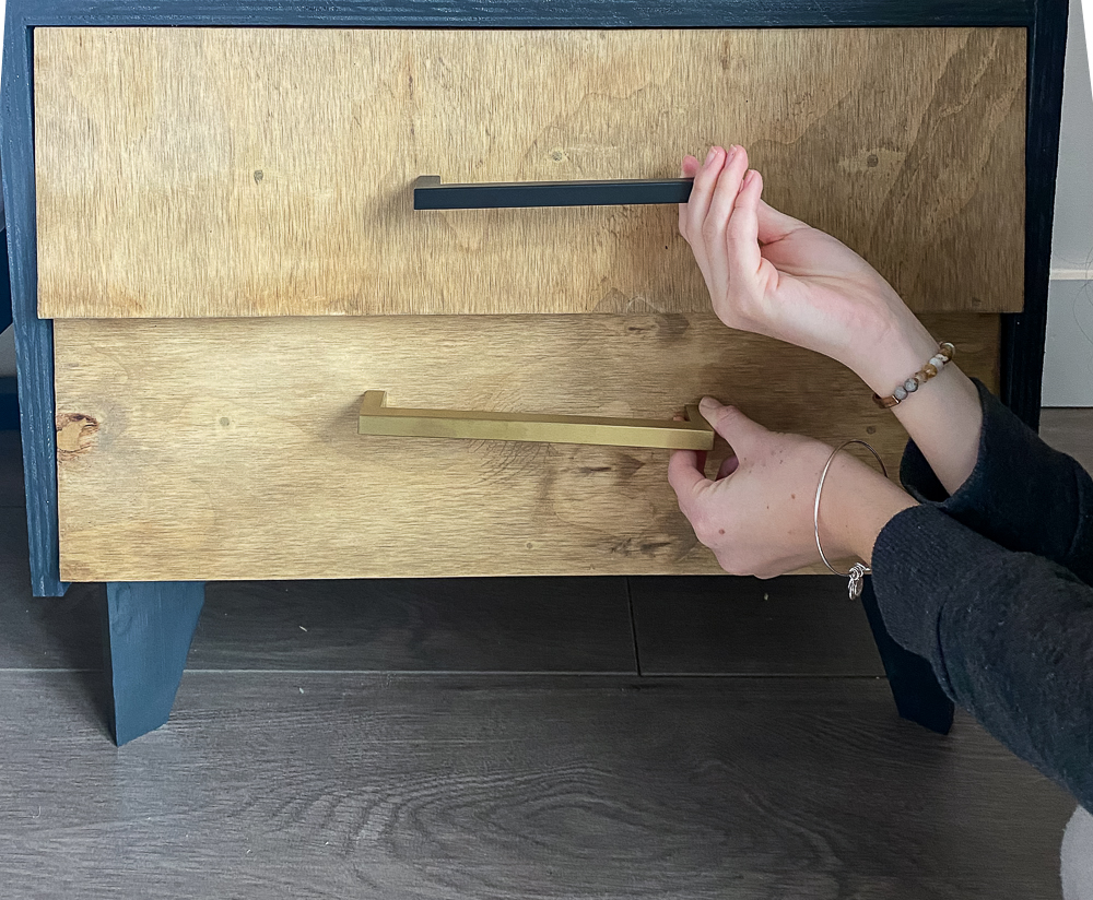 Drawer box with black and gold handles