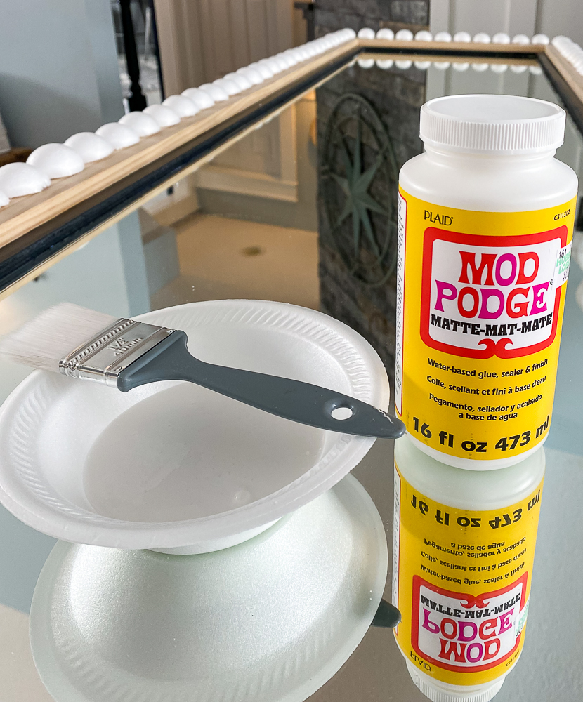 Mod Podge container with a styrofoam bowl and paint brush