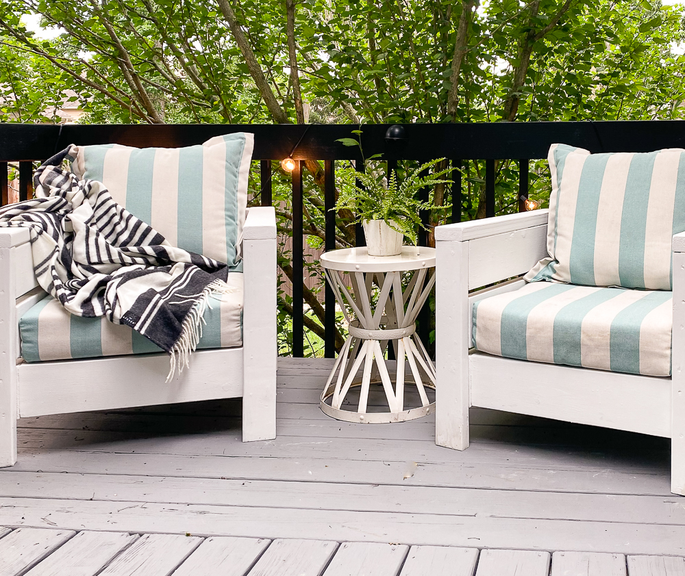 Two deck chairs with turquoise striped pillows and cushions