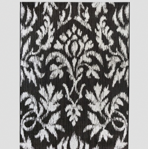 Outdoor rug with a black and white design