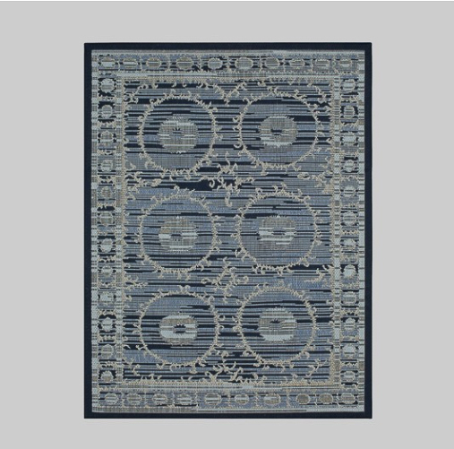 Outdoor rug with blues and greens