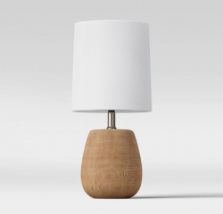 Accent lamp with brown faux wood base and white shade
