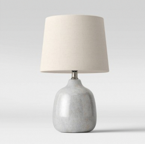 Ceramic table lamp with gray base and cream colored shade