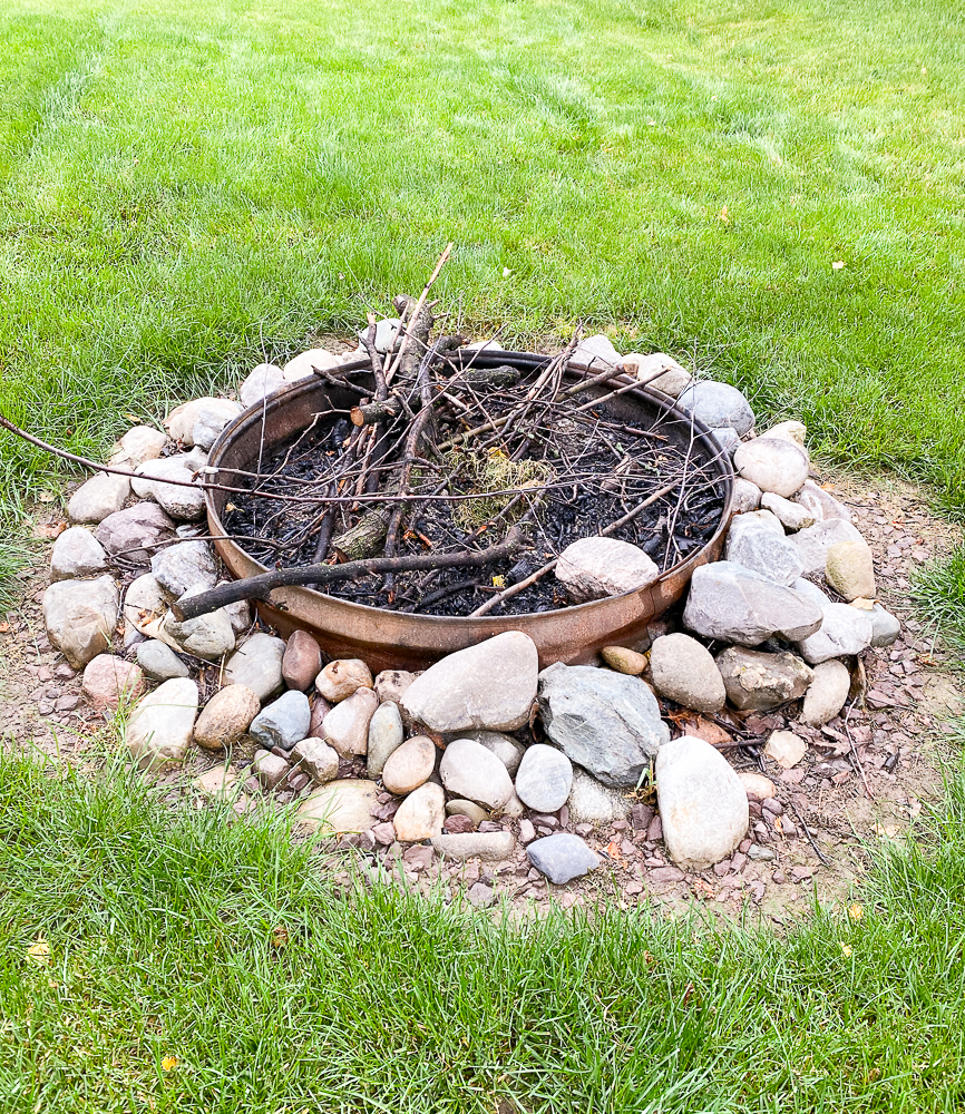Firepit made of metal with large stones around them