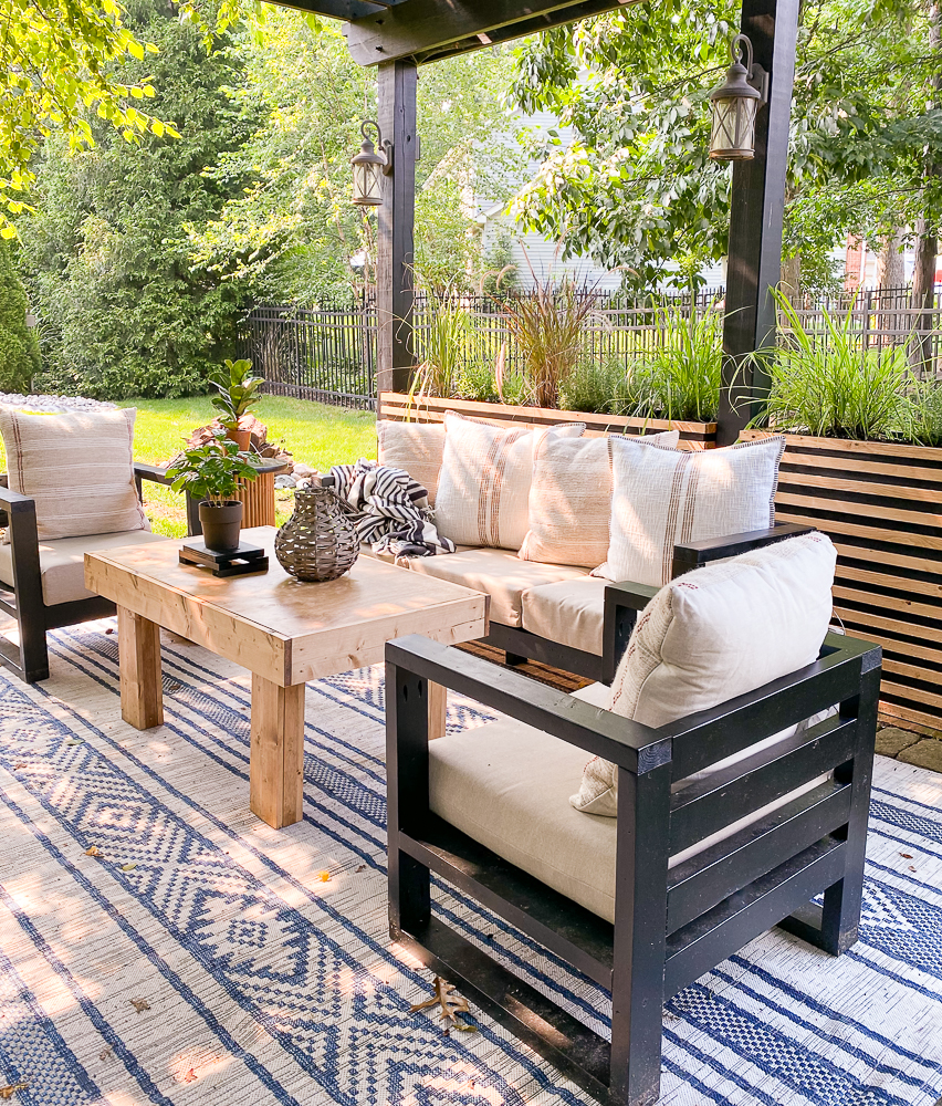 Backyard patio space with outdoor furniture and planters