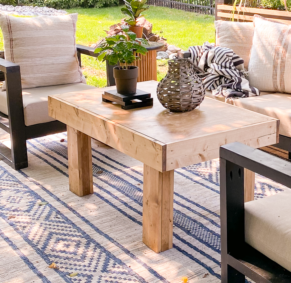 Backyard patio space with coffee table and outdoor furniture