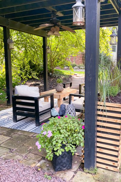 Pergola space with outdoor sofa, outdoor chairs and new planters