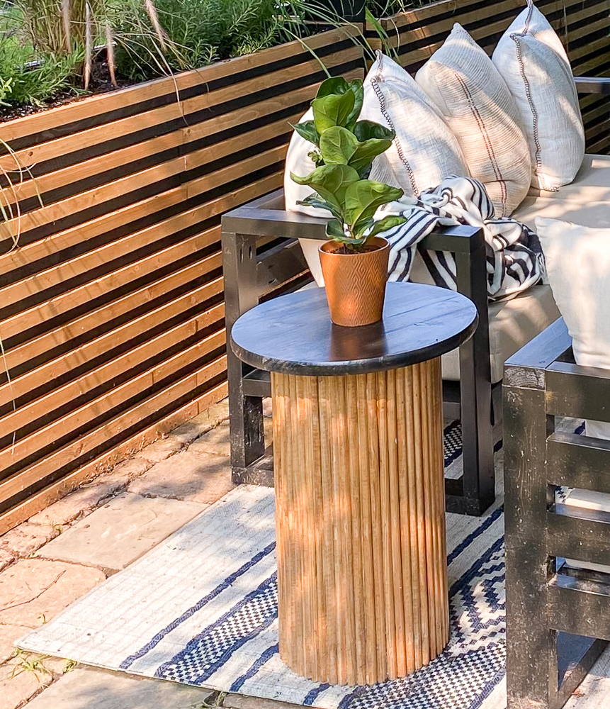 Backyard patio space with fluted round table