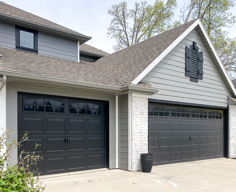Exterior design accentuated with faux windows added to black garage doors on a 2story home