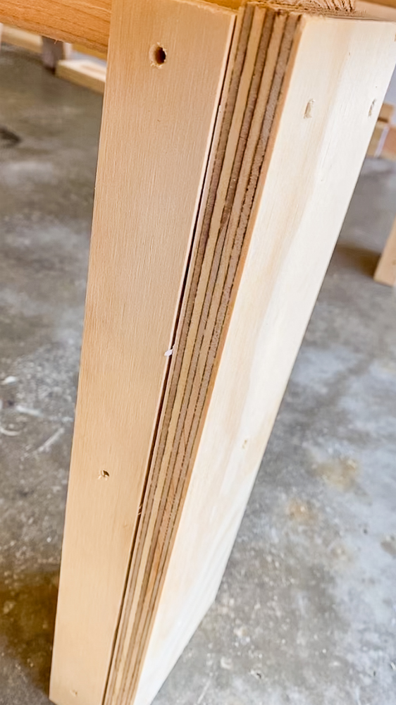 Leg to a coffee table wrapped with plywood