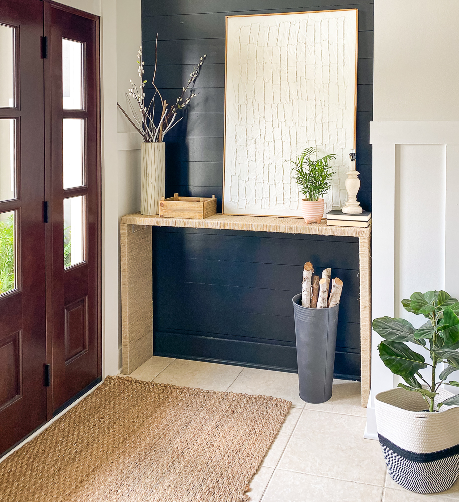 Foyer with console table and jute rug. Along with a fiddle leaf fig in a basket