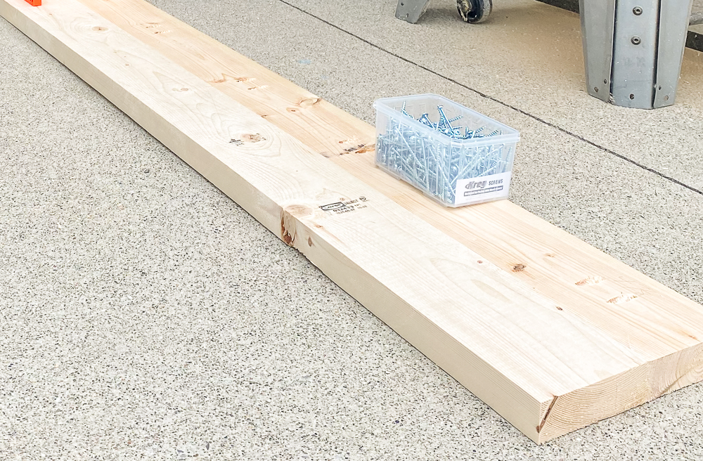 Two pine boards jigged together with box of screws on top